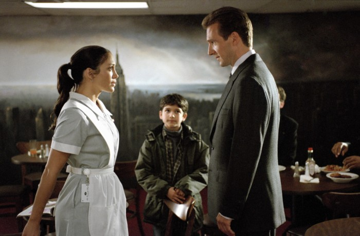 (l to r) A hotel maid (Jennifer Lopez) and her son's (Tyler Garcia Posey) true identities are discovered by the Senatorial candidate (Ralph Fiennes) who has fallen for her, in Revolution Studios' romantic comedy Maid in Manhattan, distributed by Columbia Pictures. Photo: Barry Wetcher  --- DATE TAKEN: rec'd. 12/2002  By Barry Wetcher   Columbia Pictures        HO      - handout ORG XMIT: PX85411